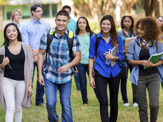 stock-photo-76462193-diverse-group-of-college-students-walking-on-beautiful-campus-1